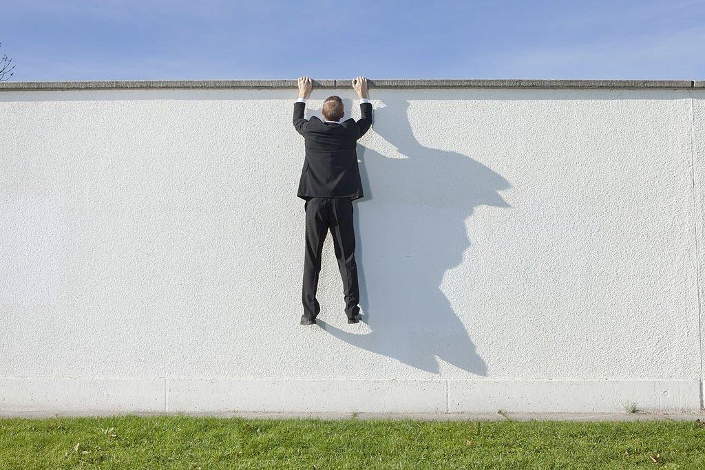 Climbs A Wall