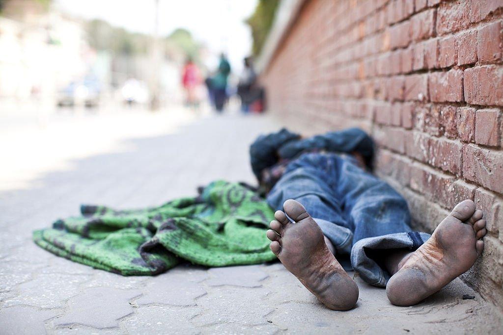 Beggar Sleeping On The Street