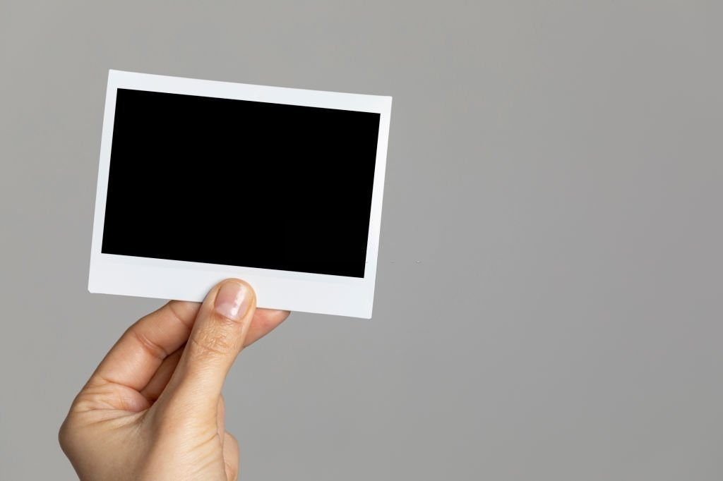 Holding A Photo