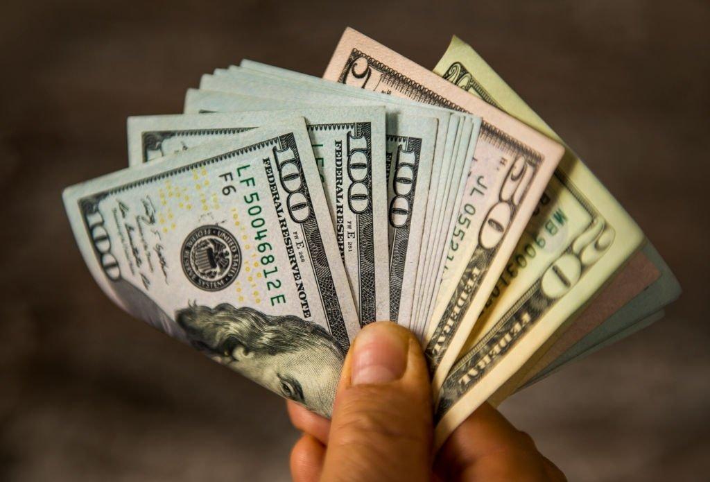 Holds Paper Money